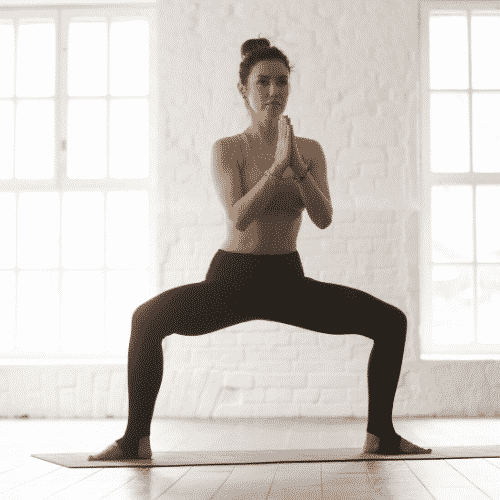 Step 2 of the fertility living room workout routine - sumo squats